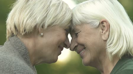 senior lifestyle : Mature mother and daughter touching heads, family relations, love and support Stock Footage