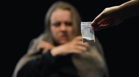 aşırı doz : Addicted female taking dose of drugs from dealer hands, withdrawal symptoms