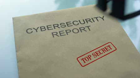 notarize : Cybersecurity report top secret, hand stamping seal on folder with documents Stock Footage