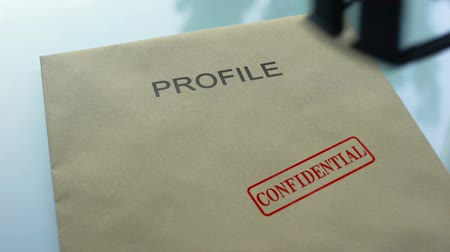 описание : Profile confidential, hand stamping seal on folder with important documents
