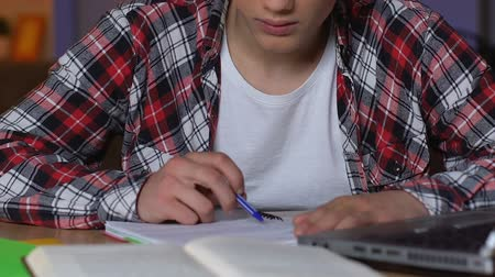 tiredness : High school student preparing to exams at night, hardly studying, close up Stock Footage