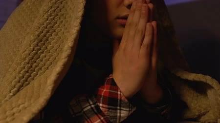 perguntando : Male kid praying covered with blanket at night, god thanksgiving, trust and hope Stock Footage