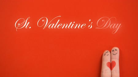 art : St Valentines Day phrase and hugging finger face couple on red background Wideo