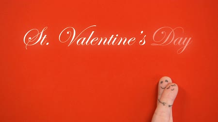 risonho : St Valentines Day phrase and hugging finger face family isolated red background Vídeos