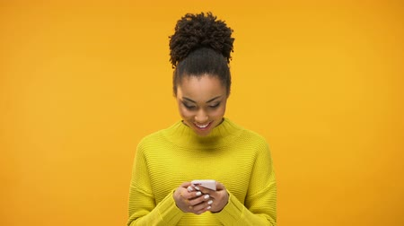 exited : African-American woman using smartphone, excited about job acceptance e-mail