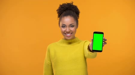 job transfer : African-American female holding smartphone, mobile application development Stock Footage