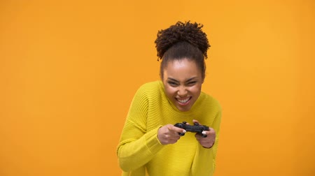nerd : Young african american woman stoutly playing video games with game controller