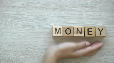 preciso : No money, hand pushing words on wooden cubes, in material need, loss and damage Vídeos