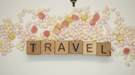 inspirar : Travel word on cubes, booking tickets and hotel rooms, adventure trip abroad