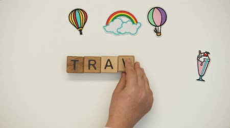inspirar : Travel word on wooden cubes made by child, school excursion, discovering new