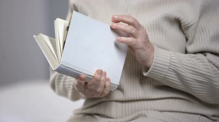 moudrý : Elderly lady wearing eyeglasses and reading book, vision problems, health care