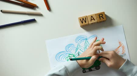 força : No war text on cubes, child painting military situation, political problems