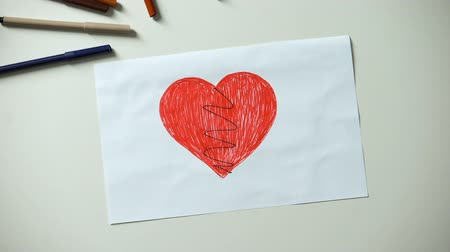 cruelty : Little child painting broken heart, cruelty and family problems concept, divorce