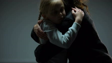 parentes : Little girl hugging adult woman, orphan child finding mother, togetherness Stock Footage