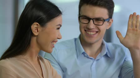businesslady : Happy asian female businesslady giving high-five to partner, successful idea Stock Footage