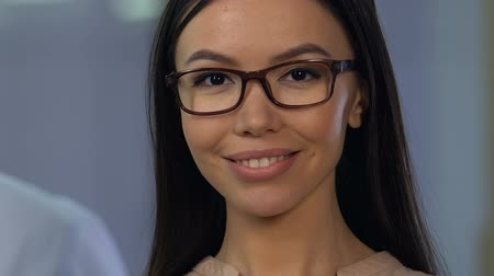branqueamento : Beautiful smiling lady in eyeglasses looking to camera, eyesight control, health