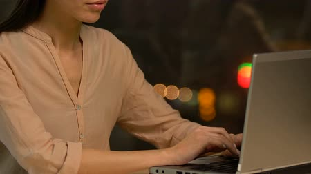 sedentary : Young female employee working on laptop, preparing financial analytics report