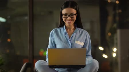 on site research : Cheerful lady typing message on dating website, flirting online with new friend