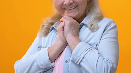 touched : Positive grandmother admiring on bright background, feeling touched, tenderness