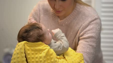 colic : Young mommy patting newborns tummy to reduce baby colic, infant healthcare