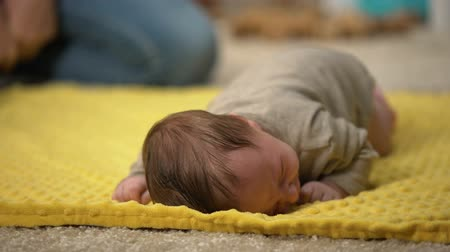 colic : Tiny adorable infant girl lying on belly trying to crawl, newborn development