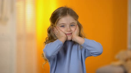 nevinný : Cute little princess playing and making funny face to camera, healthy child Dostupné videozáznamy