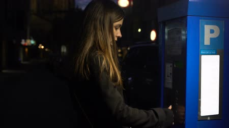 ticket machine : Lady putting coins in parking meter, walking to car, transportation service Stock Footage