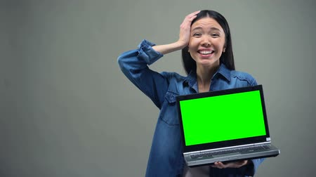 komputer : Girl holding laptop with green screen, crazy about discounts, shopping online Wideo