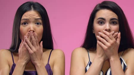 surprised : Shocked multiethnic women in pajamas closing mouth with hands, bad news, gossips