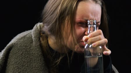 evsiz : Stressed woman drinking vodka crying for resentment and grief, hopelessness Stok Video