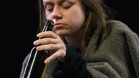 forced : Sad woman crying drinking bottled alcohol, suffering from violence, hopelessness
