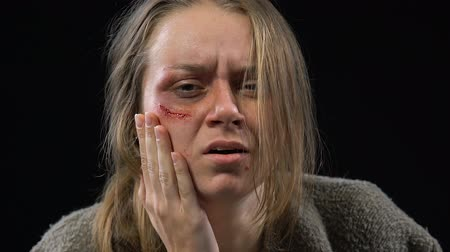 forced : Abused woman crying hard, feeling desperate and defenseless, spousal abuse