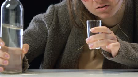 hangover : Depressed woman drinking vodka, suffering emotional pain, addiction concept Stock Footage