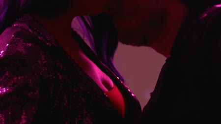 transmitted : Drunk couple passionately kissing at night club party, foreplay, one-night stand Stock Footage
