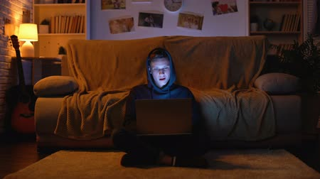 obsession : Teenager surfing in internet visiting gambling sites winning money, young hacker Stock Footage