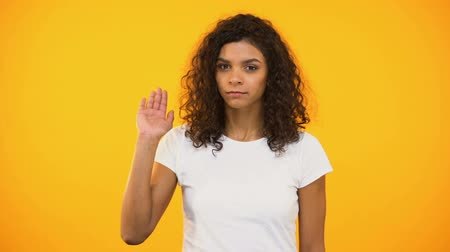 úpadek : Serious biracial woman showing no gesture to camera against yellow background