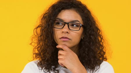durulması : Portrait of pensive girl in spectacles, pondering decision, difficult choice