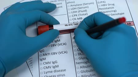 rim : Hb A1C test, doctor checking name in lab blank, showing blood sample in tube Vídeos