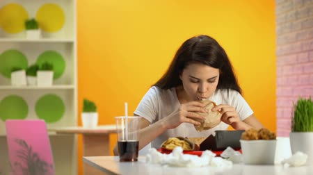 vomit : Young lady feeling nausea while tasting fast food burger, unhealthy nutrition