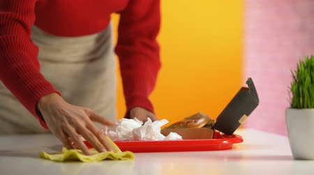 wipe away : Female waitress taking used tissue and wiping table, taking plastic tray away Stock Footage