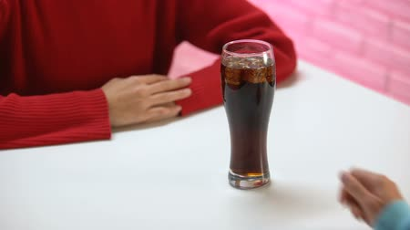 önlemek : Young female pushing away soft drink glass, unhealthy nutrition, diabetes risk