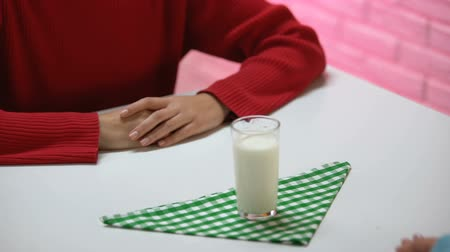 refusing : Female pushing away glass of milk, lactose intolerance, diary allergic reaction