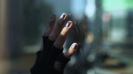 indifference : Female bum hand on restaurant window glass, poor segment of population, problem