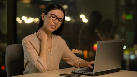 nape : Woman suffering neck pain after working on laptop for long period, muscle strain Stock Footage
