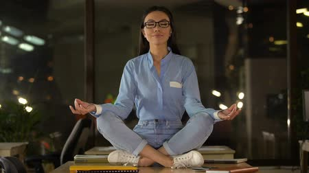 restorative : Beautiful woman meditating on office desk, break time to boost productivity
