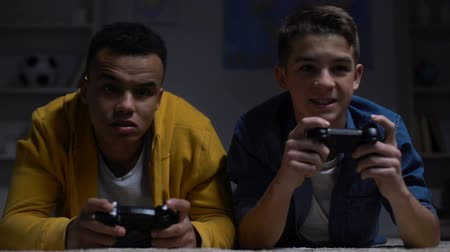 вред : Nervous multiracial guys losing computer game, accusing each other, addiction