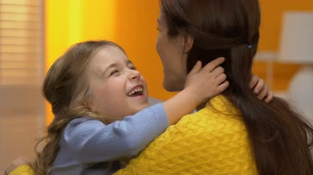 dolcezza : Adorable laughing girl hugging happy mommy, tender family relations, slow motion