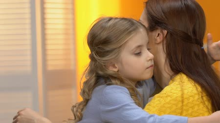 невинный : Preschool shy adopted girl hugging young lady, meeting new family, charity