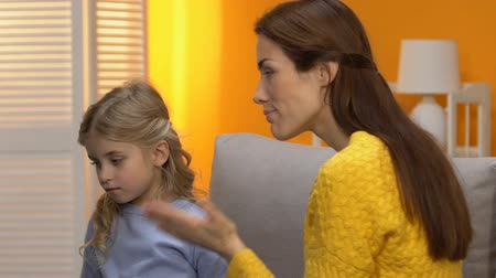 罰 : Anxious mother scolding little unhappy girl, parenting problems, aggression 動画素材