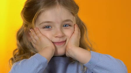 édesség : Playful little girl making funny face to camera, happy childhood, preschooler